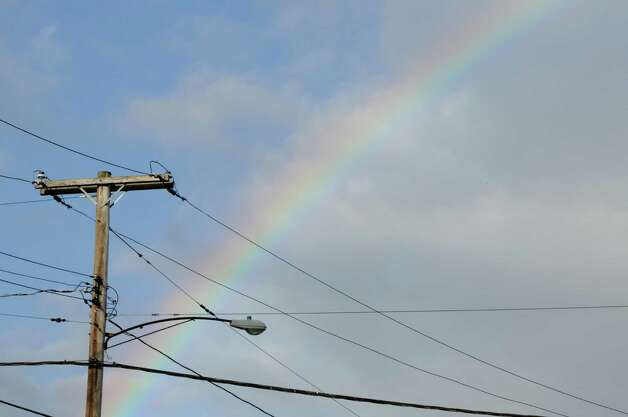 A rainbow is seen behind a utility pole on Kenwood Avenue in Delmar, N.Y. Tuesday morning Oct. 30, 2012. The Capital Region appears to have been spared any significant damage from Hurricane Sandy. (Will Waldron / Times Union) Photo: Ww