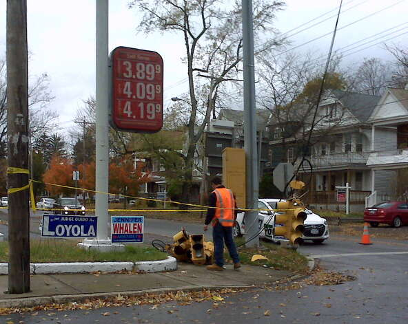 A worker tends to a downed traffic light at Brandywine Avenue and Union Street in Schenectady on Tuesday, Oct. 30, 2012. Stop signs were installed while the repair work continues. (Teresa Buckley/Times Union) Photo: Picasa