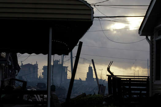Damage caused by a fire at Breezy Point is shown Tuesday, Oct. 30, 2012, in the aftermath of superstorm Sandy, in the New York City borough of Queens. The fire destroyed between 80 and 100 houses Monday night in the flooded neighborhood. Photo: Frank Franklin II, AP / AP2012