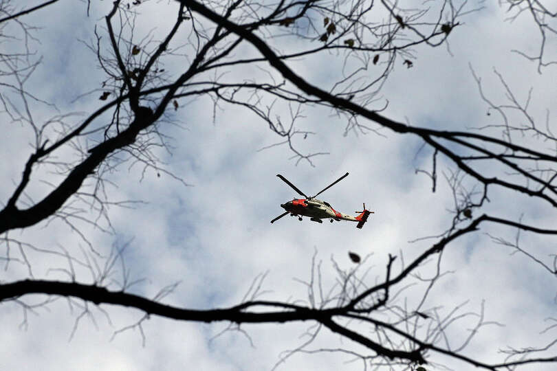A U.S. Coast Guard helicopter flies over Central Park the morning after Hurricane Sandy on October