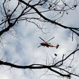 A U.S. Coast Guard helicopter flies over Central Park the morning after Hurricane Sandy on October 30, 2012 in New York City. The storm has claimed at least 16 lives in the United States, and has caused massive flooding across much of the Atlantic seaboard. US President Barack Obama has declared the situation a 'major disaster' for large areas of the US East Coast including New York City.