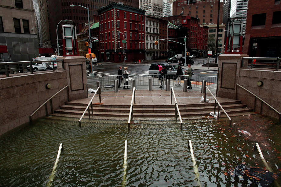 Water floods the Plaza Shops in the wake of Hurricane Sandy, on October 30, 2012 in Manhattan, New York.The storm has claimed at least 16 lives in the United States, and has caused massive flooding across much of the Atlantic seaboard. US President Barack Obama has declared the situation a 'major disaster' for large areas of the US East Coast including New York City. Photo: Allison Joyce, Getty Images / 2012 Allison Joyce