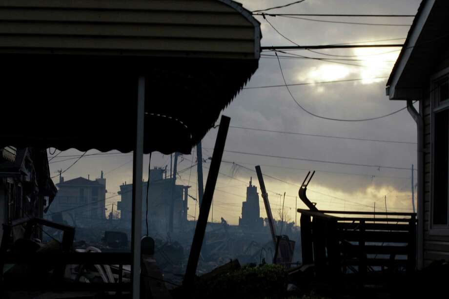 Damage caused by a fire at Breezy Point is shown Tuesday, Oct. 30, 2012, in the aftermath of superstorm Sandy, in the New York City borough of Queens. The fire destroyed between 80 and 100 houses Monday night in the flooded neighborhood. Photo: Frank Franklin II, AP / AP