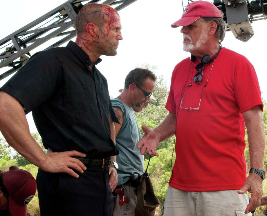 """Playing the title character, a bloodied Jason Statham converses with """"Parker"""" director Taylor Hackford Photo: FilmDistrict"""