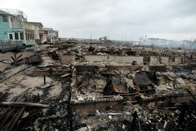 Homes destroyed by a fire at Breezy Point are shown, in the New York City borough of Queens Tuesday, Oct. 30, 2012, in New York. The fire destroyed between 80 and 100 houses Monday night in the flooded neighborhood. More than 190 firefighters have contained the six-alarm blaze fire, but they are still putting out some pockets of fire. Photo: Frank Franklin II
