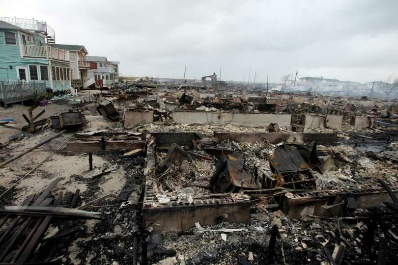 Homes destroyed by a fire at Breezy Point are shown, in the New York City borough of Queens Tuesday,