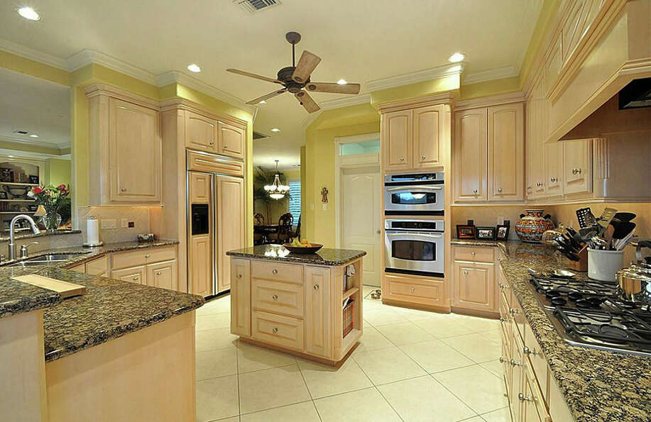 The kitchen has an island and wonderful marble counter tops.