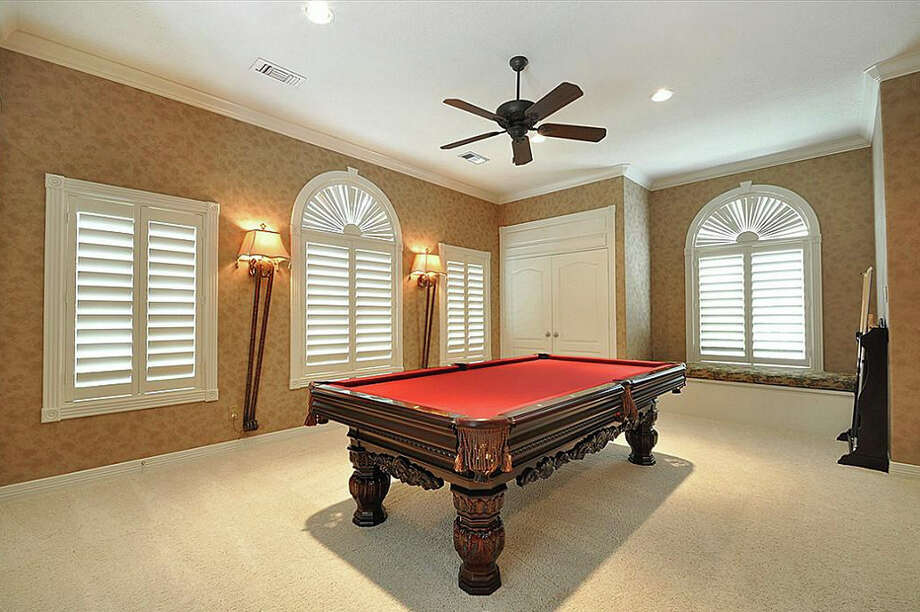 The home also has a pool table in its gameroom. Photo: Travis Nichols