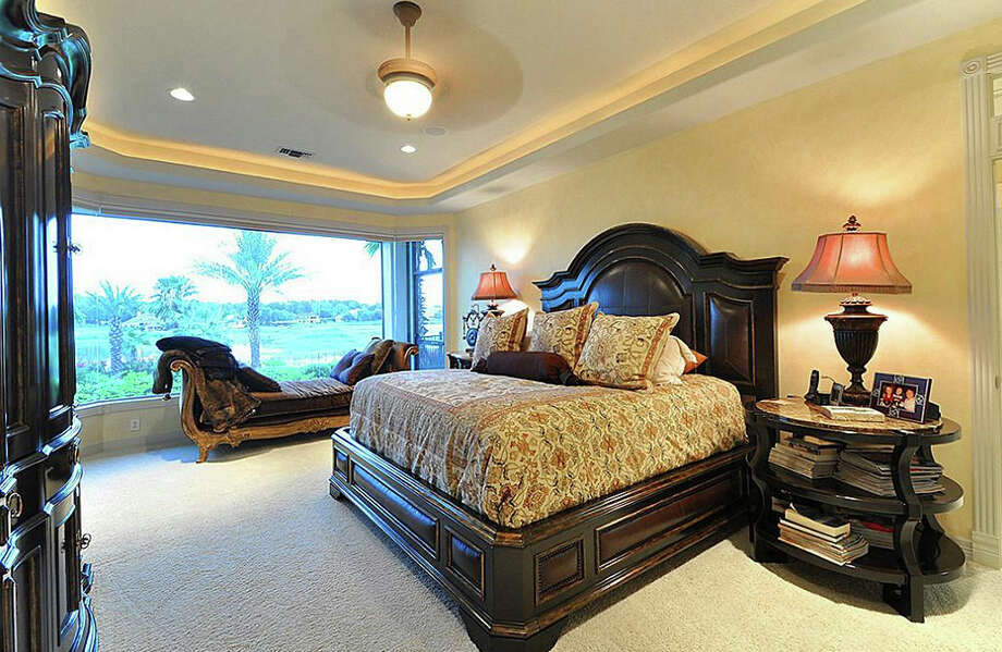The master suite isn't just spacious. It also has a beautiful view of Lake Conroe. Photo: Travis Nichols