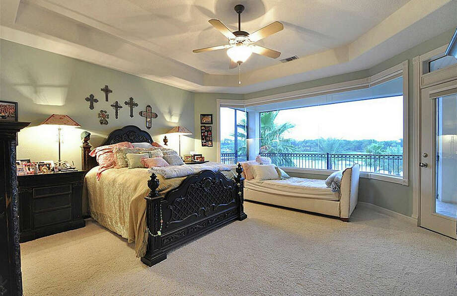 This bedroom also has beautiful views of the water. Photo: Travis Nichols