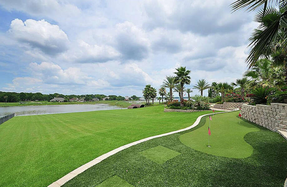 This home literally has it all, including a putting green. Photo: Travis Nichols