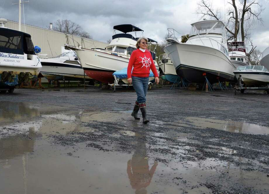 Hedy Allen, owner of the Coeyman's Landing Marina on the Hudson River walks through her boat yard Tuesday morning Oct. 30, 2012, after an overnight storm surge flooded the marina.  (John Carl D'Annibale / Times Union) Photo: John Carl D'Annibale / 10019885A