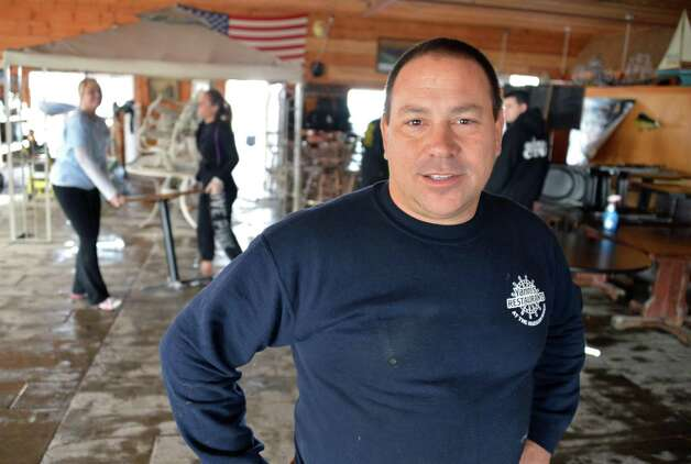 Marc Yanni, owner of Yanni's Too Restaurant at the Coeyman's Landing Marina on the Hudson River is joined by family, friends and community volunteers as they clean up Tuesday morning Oct. 30, 2012, after an overnight storm surge flooded the whole marina.  (John Carl D'Annibale / Times Union) Photo: John Carl D'Annibale / 10019885A