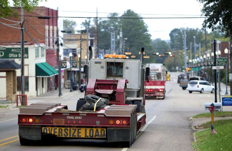 Trucks that haul equipment for TransCanada's Keystone XL project drive through downtown Winnsboro Thursday, Oct. 25, 2012, in Wood County. (Cody Duty / Houston Chronicle)