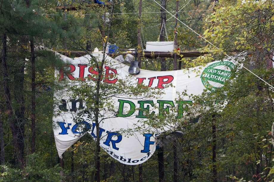 A sign hung by protesters showing their opposition for TransCanada's Keystone XL project is seen in Wood County, Wednesday, Oct. 24, 2012, in Winnsboro. Photo: Cody Duty, Houston Chronicle / © 2012 Houston Chronicle
