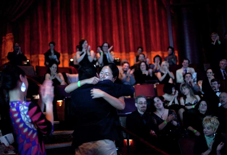 """Desdemona Chiang is embraced as she is announced as winner of the Outstanding Director for her role in """"Jesus Hopped the 'A' Train"""" during the Gregory Awards on Monday, October 29th, 2012 at Seattle's ACT Theatre. The fourth annual Gregory Awards, produced by Theatre Puget Sound, honored the best actors, directors, costume, scene, sound, music, and lighting designers. Photo: JOSHUA TRUJILLO / SEATTLEPI.COM"""