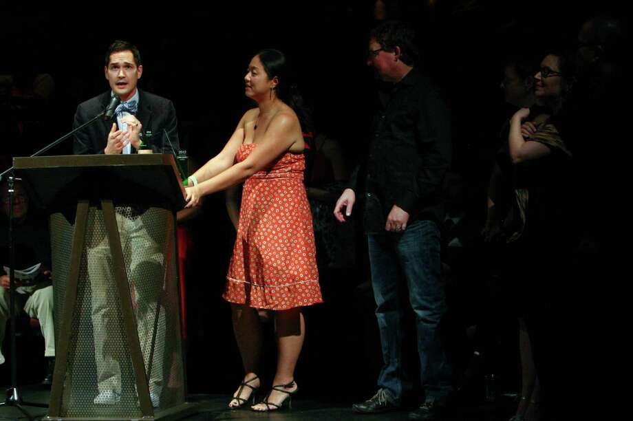 "Actor and producer Richard Nguyen Sloniker, director Desdemona Chiang, and others speak as they accept the Outstanding Production Award for ""Jesus Hopped the 'A' Train"" during the Gregory Awards on Monday, October 29th, 2012 at Seattle's ACT Theatre. The fourth annual Gregory Awards, produced by Theatre Puget Sound, honored the best actors, directors, costume, scene, sound, music, and lighting designers. Photo: JOSHUA TRUJILLO / SEATTLEPI.COM"