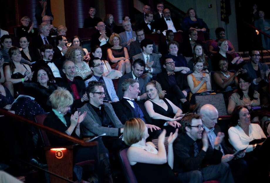 People watch the presentation during the Gregory Awards on Monday, October 29th, 2012 at Seattle's ACT Theatre. The fourth annual Gregory Awards, produced by Theatre Puget Sound, honored the best actors, directors, costume, scene, sound, music, and lighting designers. Photo: JOSHUA TRUJILLO / SEATTLEPI.COM