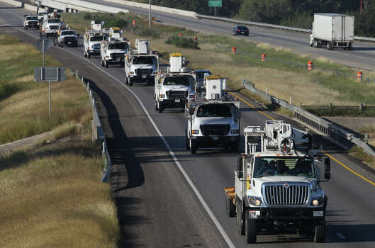 City Public Service workers drive east on Interstate 10 near Seguin Tuesday October 30, 2012. A crew of 51 workers is driving to Richmond, Virginia to help restore power in the area after Hurricane Sandy swept through area. Photo: JOHN DAVENPORT, San Antonio Express-News / San Antonio Express-News