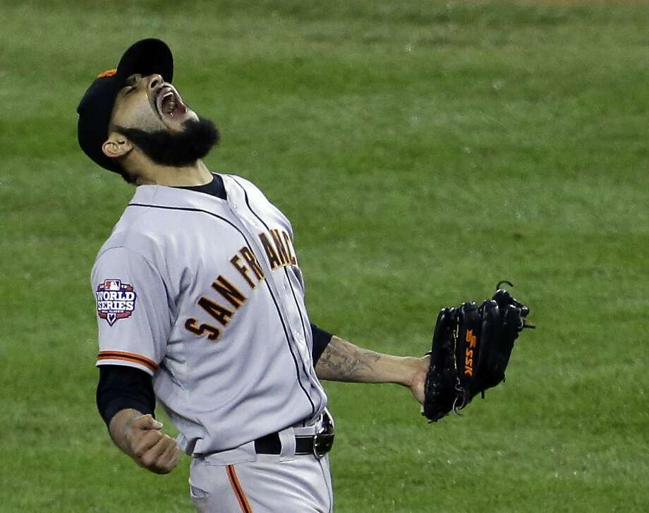 San Francisco Giants' Sergio Romo reacts after striking out Detroit Tigers' Miguel Cabrera in the 10th inning of Game 4 of baseball's World Series Sunday, Oct. 28, 2012, in Detroit. The Giants won the game 4-3 to win the World Series. (AP Photo/Patrick Semansky) Photo: Patrick Semansky, Associated Press