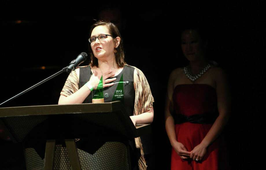 """Deanna Zibello accepts the Outstanding Scenic Design Award for her work on """"Jesus Hopped the 'A' Train"""" during the Gregory Awards on Monday, October 29th, 2012 at Seattle's ACT Theatre. The fourth annual Gregory Awards, produced by Theatre Puget Sound, honored the best actors, directors, costume, scene, sound, music, and lighting designers. Photo: JOSHUA TRUJILLO / SEATTLEPI.COM"""