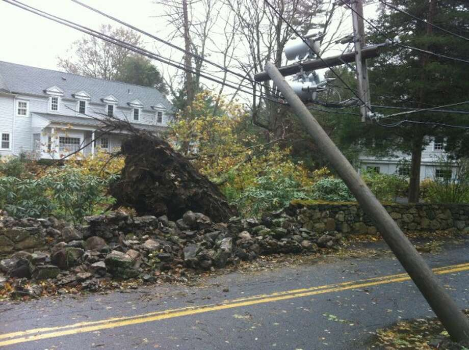 A massive oak tree crashed down into the Devlins' yard on the corner of Scofieldtown and Chestnut Hill Roads at 1:30 p.m. Monday. (Maggie Gordon)