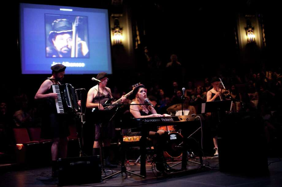 "Members of ""The Love Markets"" band perform a memorial song honoring late members of the theater community, including Drew Keriakedes and Joe Albanese, who were killed in the Cafe Racer shooting. The song was performed during the Gregory Awards on Monday, October 29th, 2012 at Seattle's ACT Theatre. The fourth annual Gregory Awards, produced by Theatre Puget Sound, honored the best actors, directors, costume, scene, sound, music, and lighting designers. Photo: JOSHUA TRUJILLO / SEATTLEPI.COM"
