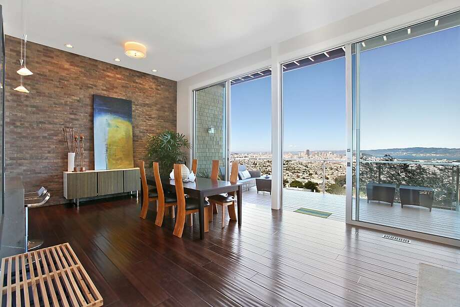 High sliding-glass doors open to an expansive deck from the main living area. Photo: OpenHomesPhotography.com