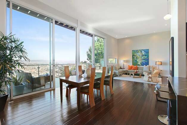 Dining area sits adjacent to the living room in an open space. Photo: OpenHomesPhotography.com