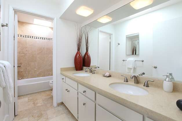 A bathroom boasts a Caesarstone dual vanity. Photo: OpenHomesPhotography.com