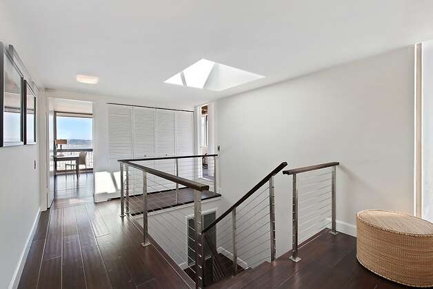 Renovated in 2008, the home has hand-hewn bamboo floors throughout. Photo: OpenHomesPhotography.com