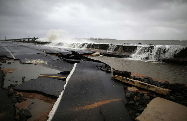 Heavy surf caused by Hurricane Sandy buckles Ocean Ave on October 30, 2012 in Avalon, New Jersey. The storm has claimed at least 16 lives in the United States, and has caused massive flooding across much of the Atlantic seaboard. US President Barack Obama has declared the situation a 'major disaster' for large areas of the US East Coast including New York City, with wide spread power outages and significant flooding in parts of the city. Photo: Mark Wilson, Getty Images / 2012 Getty Images