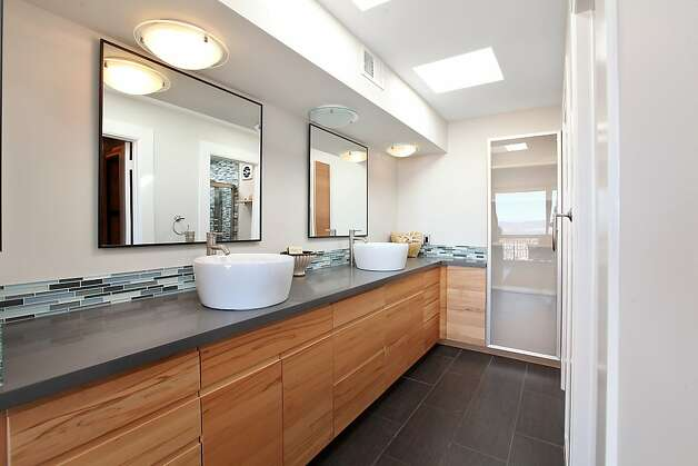 The master suite has an contemporary bathroom. Photo: OpenHomesPhotography.com