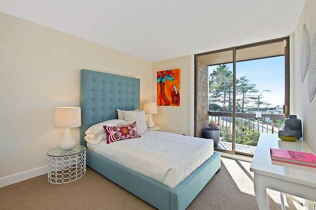 A bedroom includes access to a deck. Photo: OpenHomesPhotography.com
