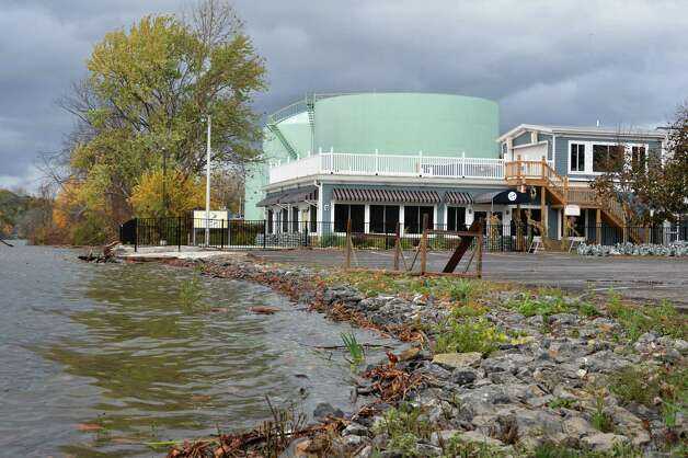 Frank Guido's Port of Call restaurant in Catskill braces for the afternoon high tide Tuesday Oct. 30, 2012, after an overnight storm surge flooded the Catskill Creek at the mouth of the Hudson River.  (John Carl D'Annibale / Times Union) Photo: John Carl D'Annibale / 10019885A