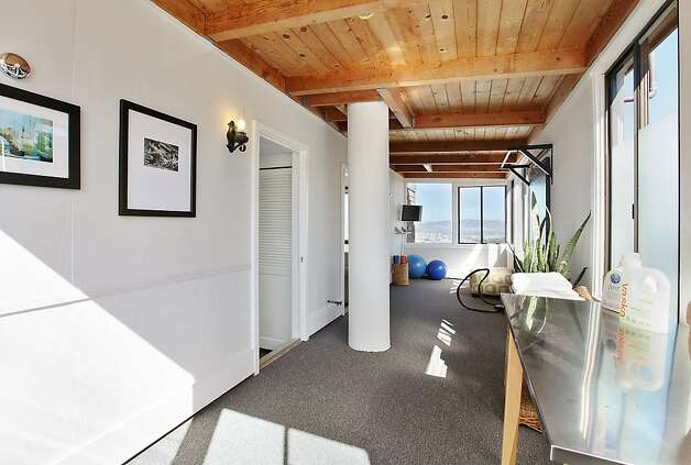 This Diamond Heights luxury home was extensively renovated in 2008 and comes outfitted with a four view decks, designer lighting, and a high-tech sound system. Photo: OpenHomesPhotography.com