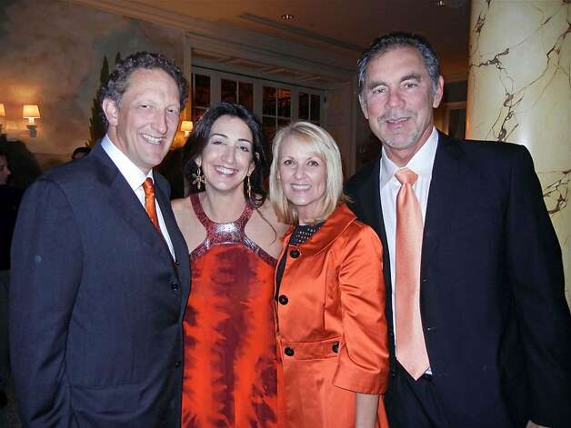 Giants CEO Larry Baer (left) with his wife, Pam Baer; and Kim Bochy and her husband, Giants manager Bruce Bochy, at the Fairmont Hotel fete. Photo: Catherine Bigelow, Special To The Chronicle