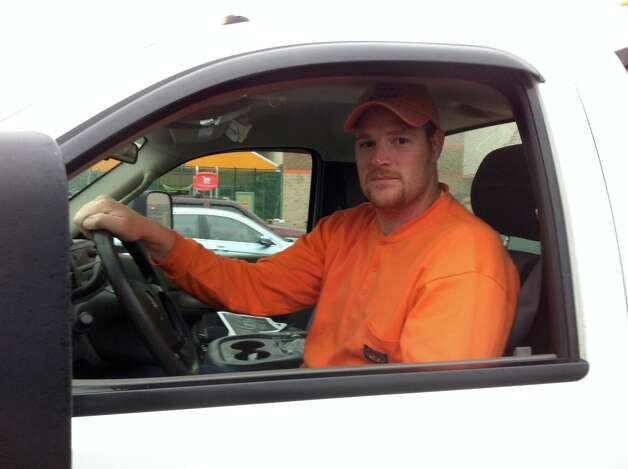 Mike Dahlheimer, who works for utility contractor Bond Brothers, heads to work in Bridgeport after grabbing some supplies from Home Depot in Stratford on Monday before Sandy hit. Photo: Rob Varnon, Rob Varnan