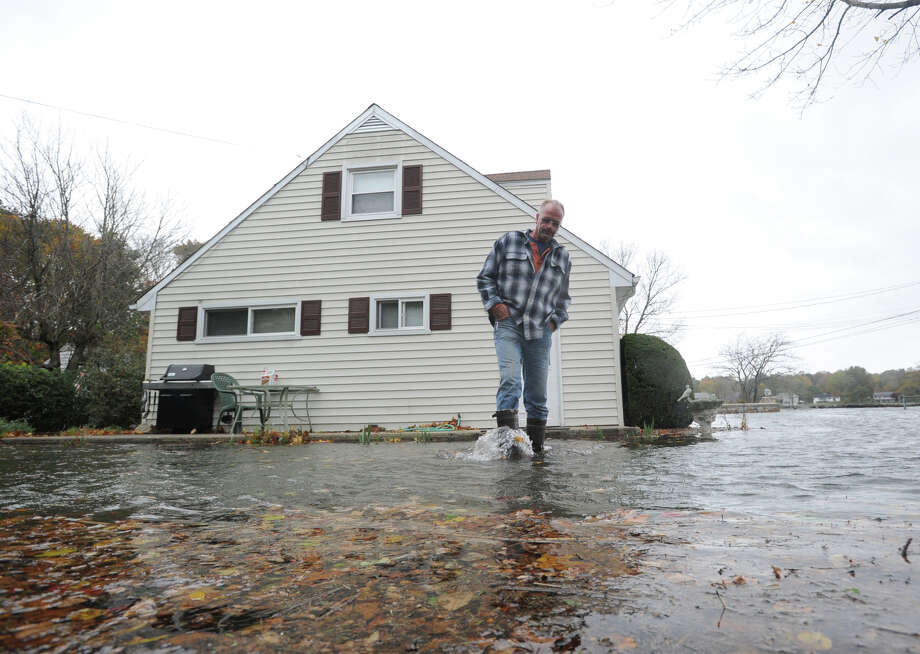 Eugene Sullivan walks through the water surrounding his home during Hurricane Sandy on Weed Avenue in Stamford, Monday morning, Oct. 29, 2012. Photo: Bob Luckey / Greenwich Time
