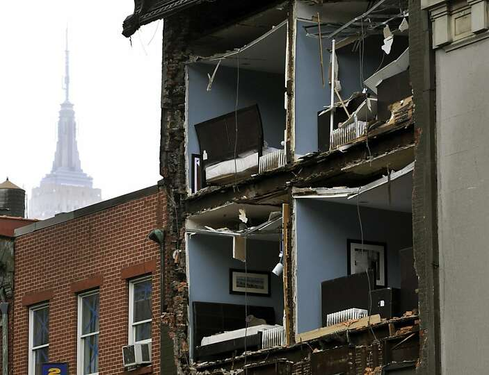 The Empire State Building towers in the background of an apartment buliding in Chelsea, New York Cit