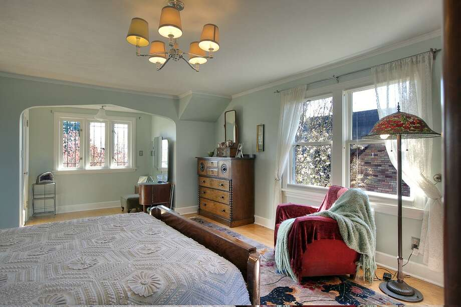 Bedroom of 3015 28th Ave. W. The 3,090-square-foot brick Tudor, built in 1930, has four bedrooms, 2.25 bathrooms, coved ceilings, mahogany trim, French doors, a lower-level rec room with a fireplace, a deck, and water and mountain views on a 6,000-square-foot lot. It's listed for $849,900. Photo: Gordon Wang/Courtesy Marta Brace/Admiral Realty