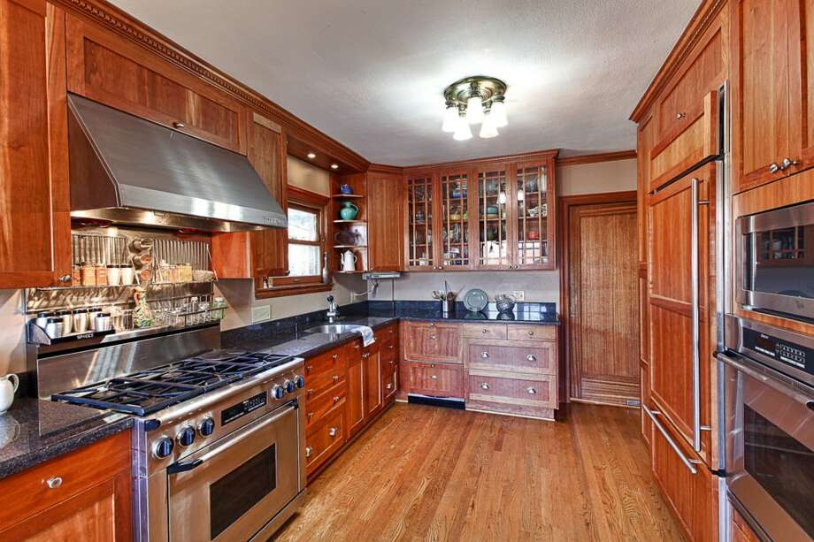 Kitchen of 3015 28th Ave. W. The 3,090-square-foot brick Tudor, built in 1930, has four bedrooms, 2.25 bathrooms, coved ceilings, mahogany trim, French doors, a lower-level rec room with a fireplace, a deck, and water and mountain views on a 6,000-square-foot lot. It's listed for $849,900. Photo: Gordon Wang/Courtesy Marta Brace/Admiral Realty