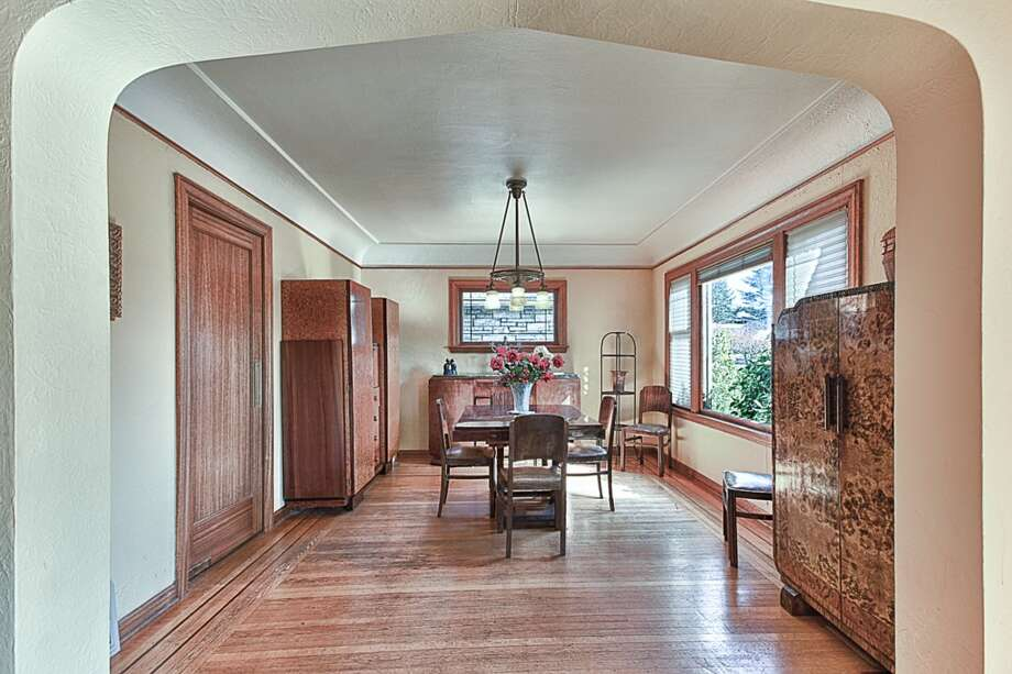 Dining room of 3015 28th Ave. W. The 3,090-square-foot brick Tudor, built in 1930, has four bedrooms, 2.25 bathrooms, coved ceilings, mahogany trim, French doors, a lower-level rec room with a fireplace, a deck, and water and mountain views on a 6,000-square-foot lot. It's listed for $849,900. Photo: Gordon Wang/Courtesy Marta Brace/Admiral Realty