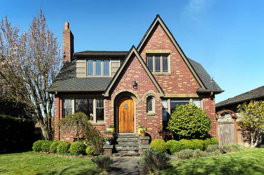 Magnolia is a uniquely situated neighborhood close to downtown Seattle, yet set apart, along Elliott Bay and Puget Sound. Here are three homes listed there for less than $900,000, starting with 3015 28th Ave. W. The 3,090-square-foot brick Tudor, built in 1930, has four bedrooms, 2.25 bathrooms, coved ceilings, mahogany trim, French doors, a lower-level rec room with a fireplace, a deck, and water and mountain views on a 6,000-square-foot lot. It's listed for $849,900. Photo: Gordon Wang/Courtesy Marta Brace/Admiral Realty