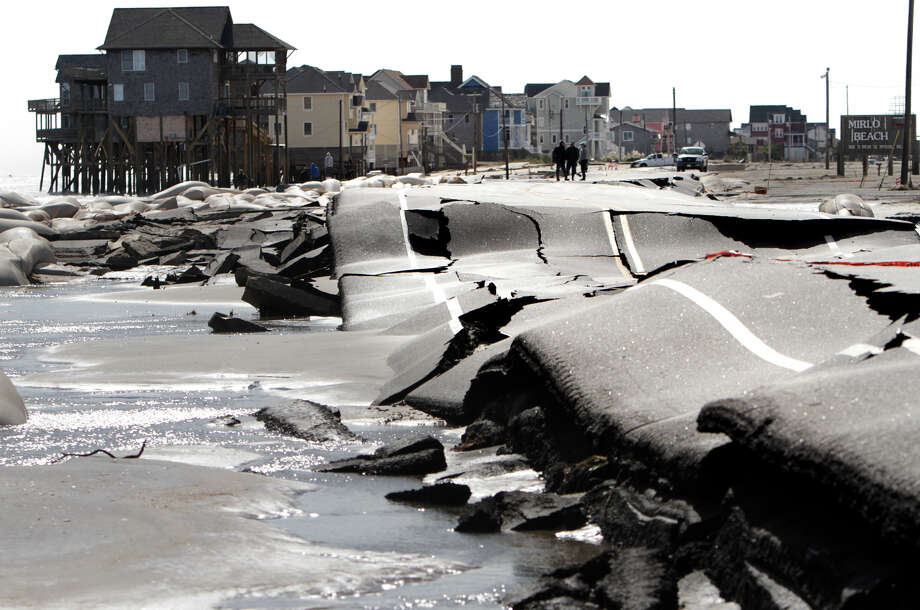 "Poor roads cause headaches for everybody. Until Congress can agree on funding for America's crumbling road infrastructure, we all have to pay. Keep clicking to see states with the highest percentage of ""poor"" roads and the costs that drivers incur.Source: Washington Post Photo: Steve Earley, Associated Press / The Virginian-Pilot"