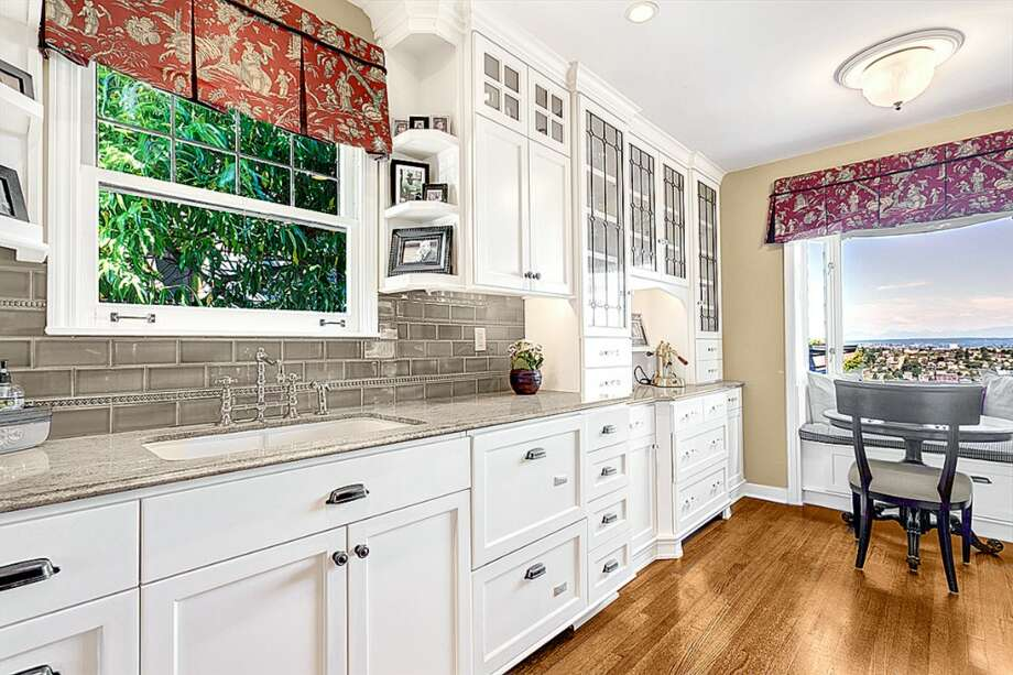 Kitchen of 3228 Whalley Place W. The 3,000-square-foot home, built in 1932, has five bedrooms and 3.25 bathrooms -- including a master suite with a spa bath -- French doors leading from the dining room to a view deck, a media room and a carriage house on a 6,339-square-foot lot. It's listed for $899,950. Photo: Courtesy Jeffrey Valcik/Windermere Real Estate