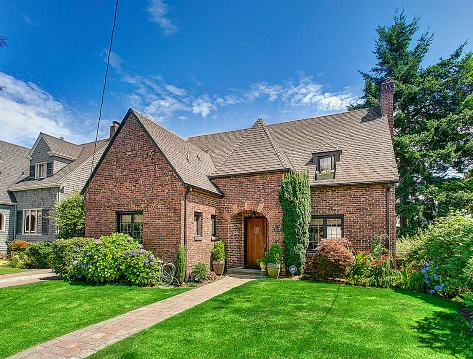 Sticking with the brick-Tudor theme, here's 3228 Whalley Place W. The 3,000-square-foot home, built in 1932, has five bedrooms and 3.25 bathrooms -- including a master suite with a spa bath -- French doors leading from the dining room to a view deck, a media room and a carriage house on a 6,339-square-foot lot. It's listed for $899,950. Photo: Courtesy Jeffrey Valcik/Windermere Real Estate