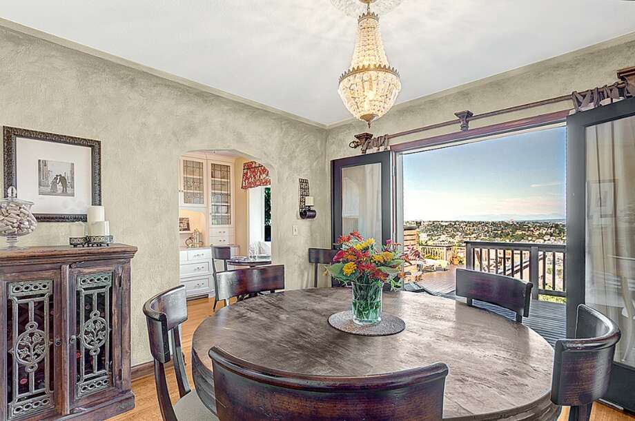Dining room, with French doors leading to deck, of 3228 Whalley Place W. The 3,000-square-foot home, built in 1932, has five bedrooms and 3.25 bathrooms -- including a master suite with a spa bath -- a media room and a carriage house on a 6,339-square-foot lot. It's listed for $899,950. Photo: Courtesy Jeffrey Valcik/Windermere Real Estate