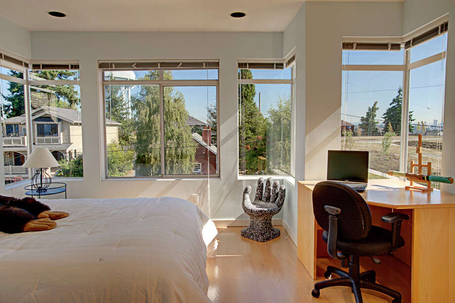 Bedroom of 4000 W. Dravus St., is more contemporary. The 3,260-square-foot house, built in 1992, has three bedrooms and 2.75 bathrooms -- including a master suite with a five-piece bathroom -- a surround sound system, a patio, multiple balconies, a rooftop deck and a two-car garage. It's listed for $850,000. Photo: John G. Wilbanks/Courtesy Ally Wangsness/RE/MAX Metro Realty