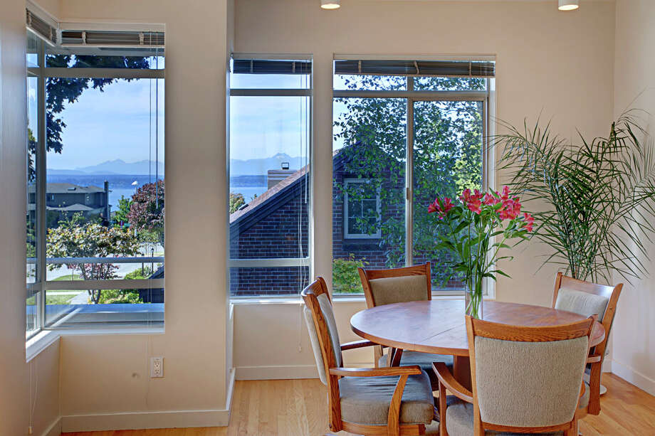 Breakfast nook of 4000 W. Dravus St., is more contemporary. The 3,260-square-foot house, built in 1992, has three bedrooms and 2.75 bathrooms -- including a master suite with a five-piece bathroom -- a surround sound system, a patio, multiple balconies, a rooftop deck and a two-car garage. It's listed for $850,000. Photo: John G. Wilbanks/Courtesy Ally Wangsness/RE/MAX Metro Realty